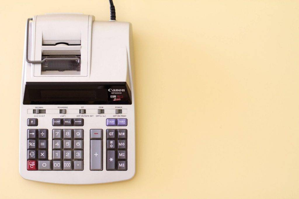 Decorative image of a '90s calculator with printing mechanism