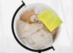 A globe map with a post-it note with